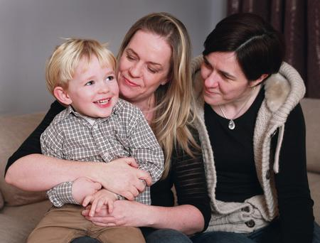 Caodhan with his two mums, Lucille and Elaine
