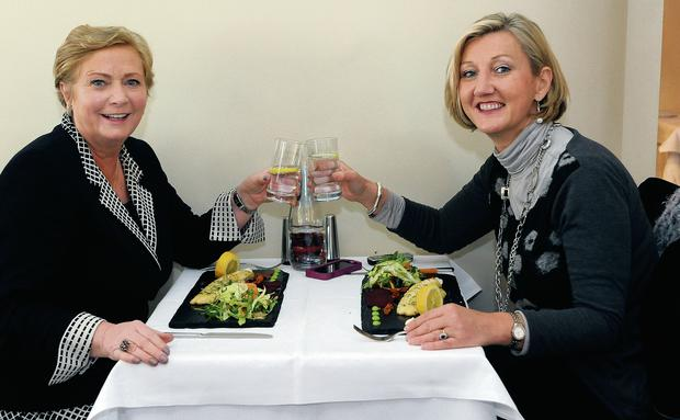 Table for two: Minister Frances Fitzgerald with Miriam Donohue at La Banca in Lucan, Co Dublin. Photo: Dave Meehan