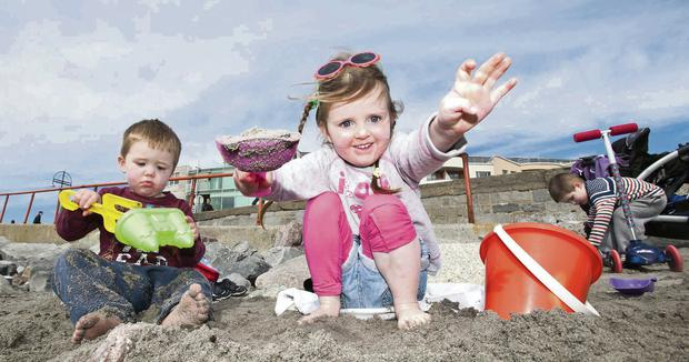 Rhys Warde, Lila Foley and Alex Warde from Knocknacarra getting into the spirit of Summer on the beach in Salthill, Galway yesterday.