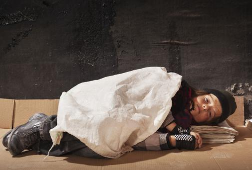 Homeless boy sleeps rough. Picture posed.