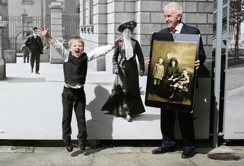 Arts Minister Jimmy Deenihan with Andrew Murphy O'Donovan (6) at the launch of 10, 500 newly-digitised images.