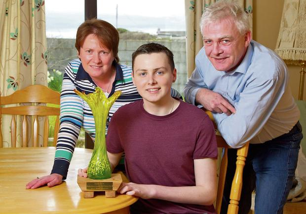 Donal Walsh with his parents Fionnbarr and Elma