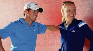Rory McIlroy and Caroline in Abu Dhabi in 2014