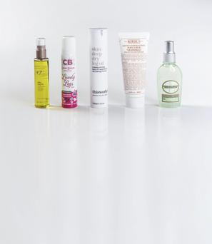 Pictured from left: Boots No7 Silky Leg Oil; Cocoa Brown Lovely Legs Spray; This Works Skin Deep Dry Leg Oil; Kiehl's Gently Exfoliating Body Scrub Grapefruit; L'Occitane Almond Tonic Body Oil