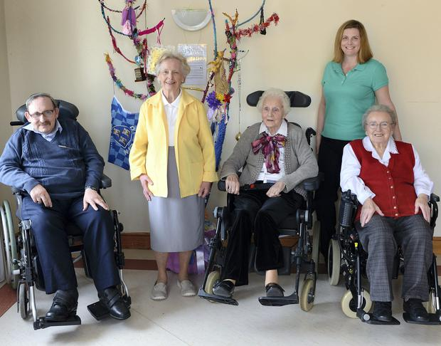 Residents of Kiltipper Woods Care Centre. From left: Roderick Hanley; Annie Thornberry; Carmel Royston; Clare Healy, Activities Co-Ordinator; Phyllis O'Reilly.
