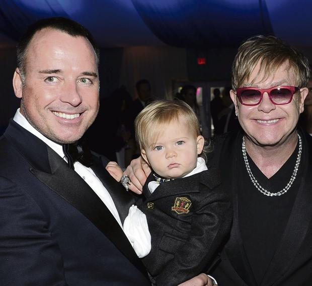 David Furnish, son Zachary and Sir Elton John.