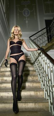 Kate Moss poses as part of a publicity campaign for underwear retailer Agent Provocateur. Photo: Reuters