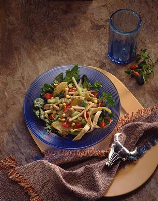 Chicken salad with chickpeas, peppers and lemon.