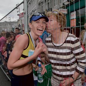 Lizzie Lee getting a kiss from her mum Mary after winning the Cork City Half Marathon