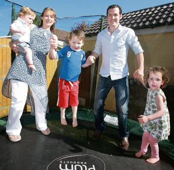 Ups and downs: Niamh Broderick with husband John and their children.