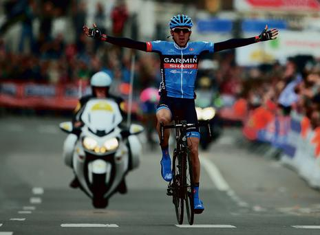 Daniel Martin of Garmin-Sharp crosses the finish line to win the Liege-Bastogne-Liege road race last year