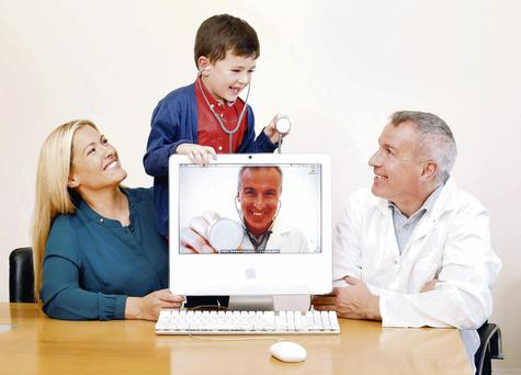 Mum Sinead Kearney with her son Allan (5) and Declan Sherry as the doctor at the launch of the new HSF Health Plan service