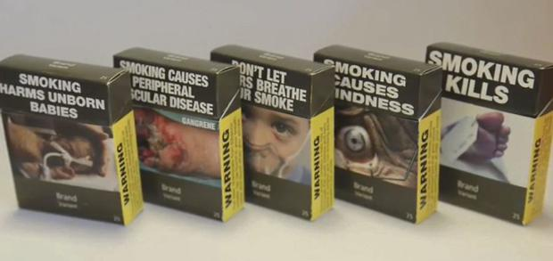 Cigarette packets showing the effects of smoking