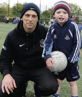 Dublin footballer Mick Casey with son Michael (6) at the nursery at Lucan Sarsfields in Dublin