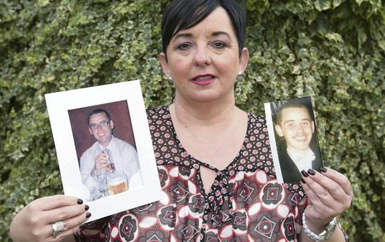 Mary O'Neill with her two brothers, Barry (left) and Darren (right), who both took their own lives.