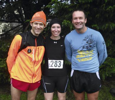 Alex O'Shea (left), winner of the ESB 5k cross-country with Maura Regan and Mick Daly. Photo: John Walsh