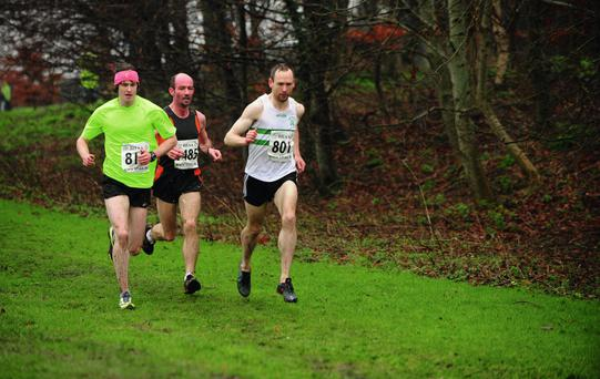 Eventual winner, Kevin Maunsell (right), UCD, with third-placed Robbie Matthews (centre), and second-placed Michael Carmody (left), during the BHAA Eircom cross-country at Tallaght. Photo: Tomás Greally