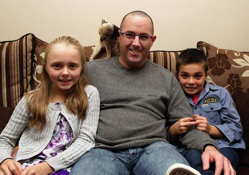 Brendan Lynch from Kells Co Meath who suffers from Lupus with his children Chloe (12) and Scott (8) and their pup Milly