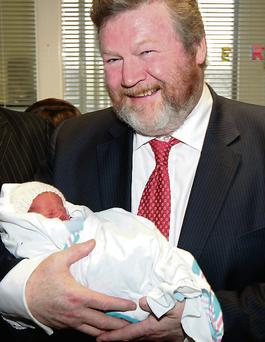 Health Minister James Reilly with newborn Alex Kavanagh when he opened new patient facilities at Mount Carmel in 2012. Brian McEvoy