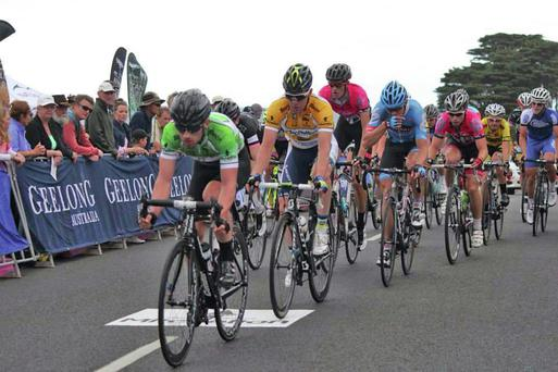 Action from the criterium, with Felix English pictured in green.