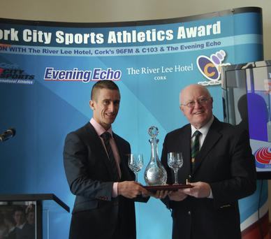 Robert Heffernan receiving the Cork City Sports Athletics Person of the Year award from Tony O'Connell, Chairman of the Cork City Sports. John Walshe