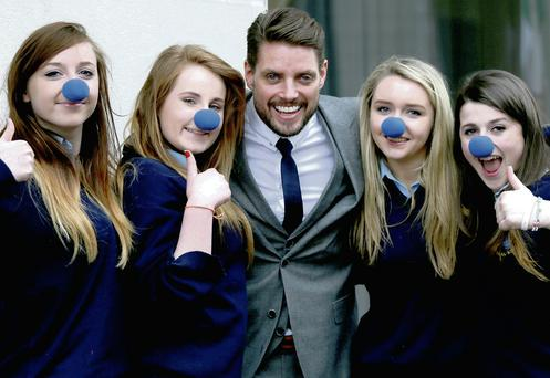 Boyzone's Keith Duffy with Chloe McKenna, Ciara Gallogly, Kerrie Hyland and Clodagh Murray, who are wearing blue noses for Autism Awareness Month.