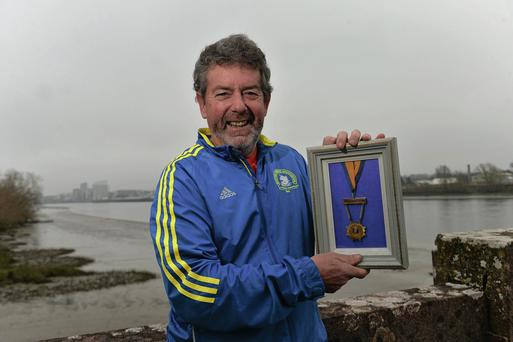 Neil Cusack with his 1974 Boston Marathon gold medal.