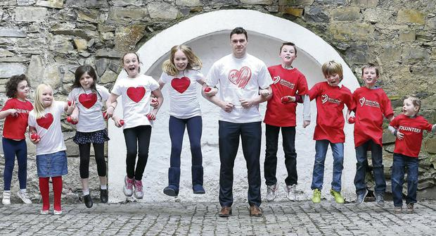 Dublin GAA Star Paddy Andrews and a group of Happy Heart children get together to launch the Irish Heart Foundation (IHF) appeal for volunteers