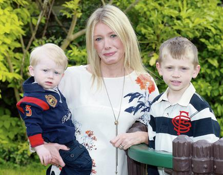 Lindsay Sheridan with her sons, Joe (4) and Harry (1). Surgery may hold the key to resolving her epilepsy