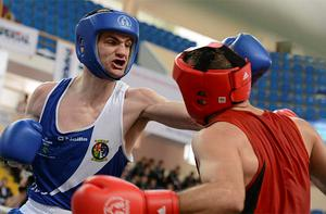 Adam Nolan, left, Ireland, exchanges punches with Ionut Gheorghe, Romania, during their Welterweight 69kg bout. Photo: Sportsfile