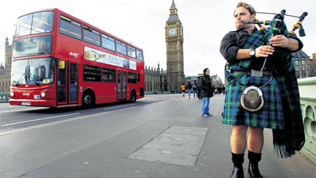 A bagpiper plays for tourists near the Houses of Parliament in London last week