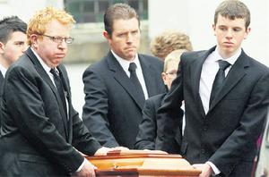Tommy Fleming (left) helps carry a coffin at the funeral of his parents Annie and Paddy in Kilmactigue, Aclare, Co Sligo, yesterday