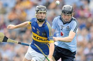 Tipperary's Mark McCarthy keeps his eyes trained on the sliotar despite the close attention of Dublin's Shane Barrett during yesterday's All-Ireland MHC final