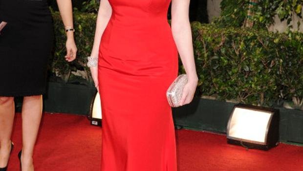 BEVERLY HILLS, CA - JANUARY 16:  Actress Christina Hendricks arrives at the 68th Annual Golden Globe Awards held at The Beverly Hilton hotel on January 16, 2011 in Beverly Hills, California.  (Photo by Jason Merritt/Getty Images)