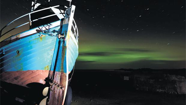 The Northern Lights as seen from the shoreline at Urris on the Inishowen Peninsula