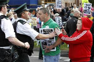 A man tussles with PSNI Officers during the protest. Photo: PA