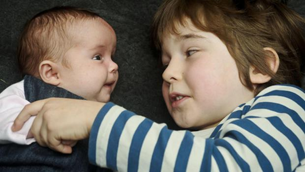Twins Reuben Blake, five with his twin Floren seven weeks, who were conceived from the same batch of embryos but born five years apart to parents Simon, 45 and Jody Blake 38, at their home in Cheltenham. Photo: PA