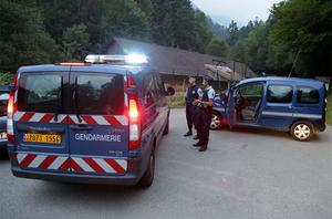 Gendarmes block access to the killing site near Chevaline, French Alps Photo: PA