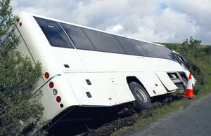The bus ended up on its side in a ditch