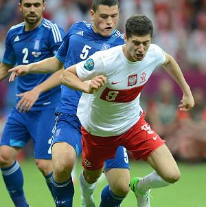 Robert Lewandowski (right) is keeping tight-lipped over a potential move to Manchester United