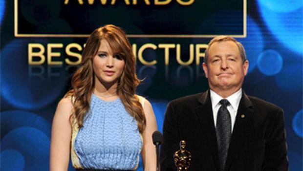 Actress Jennifer Lawrence (L) and Academy of Motion Picture Arts and Sciences President Tom Sherak speak onstage during the Academy Awards announcement. Photo: Getty Images