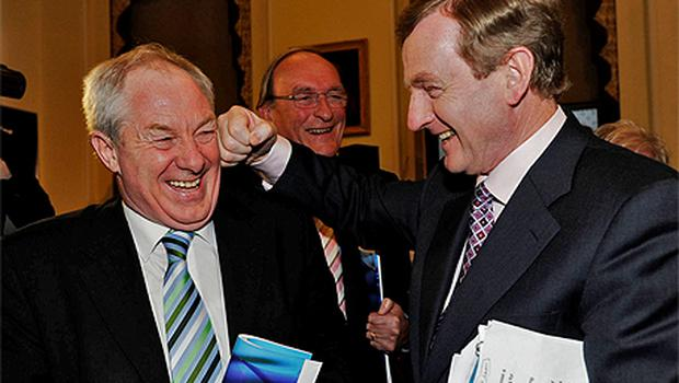 Fine Gael leader Enda Kenny joking with constituency colleague Michael Ring at the launch of the party's manifesto yesterday