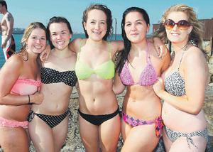 Jenny Stokes, Colleen Dobry and Leah Fritz, from the US, and Jo Doyle and Eleanor Hutch, from Dalkey, reprised their bikinis in Sandycove, Dublin