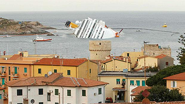 The stricken Costa Concordia lies on on a rocky outcrop off the Italian coast
