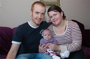 Sive McDonald with her parents John and Aisling McDonald