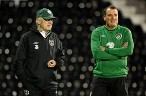 Giovanni Trapattoni and Marco Tardelli keep a watchful eye on the Irish training session at Craven Cottage last night ahead of tonight's friendly international against Oman