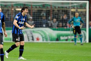 Diego Milito celebrates Inter Milan's third goal during last night's Champions League semi-final, first leg at the San Siro. Photo: Getty Images