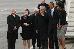 President Obama and his wife Michelle with Dan Rooney (centre), Patricia Rooney (2nd left), and Eamonn Gilmore (3rd right). Photo: PA