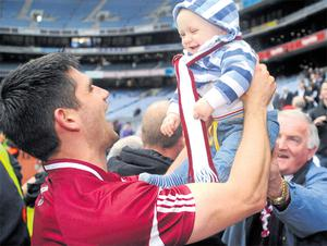 Fergal Moore celebrates a famous win with his nephew, Darragh Coen