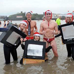 Temperatures were mild for this year's festive swimmers at Tenby, west Wales, compared to last year's freezing conditions